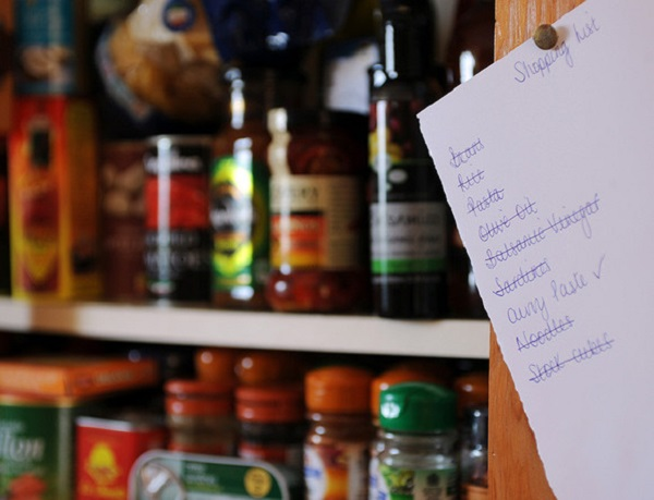 shopping list on food cupboard